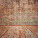 Concrete brick walls and wood floor for text and background. Stock Photo