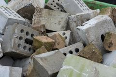 Concrete bricks construction material laying in skip on each other heap Stock Image