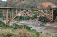 Concrete Bridge. An arc bridge in truss concrete. The clear spanning arc over the Paraiba do Sul River, Rio de Janeiro State, Brazil Stock Photo