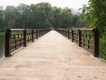 Concrete bridge across the river, perspective view Stock Photos