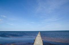 Concrete bridge at coast. With blue water and blue sky Stock Photos