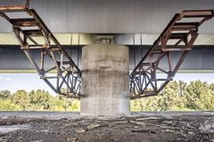 Concrete bridge column construction. Concrete and metallic bridge column construction close-up background royalty free stock photo