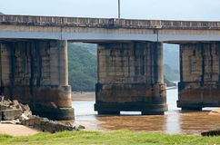 Concrete bridge outside Port Shepstone, Kwazulu Natal. Mzimkhulu river flowing to the sea under concrete bridge outside Port Shepstone, Kwazulu Natal Royalty Free Stock Photos