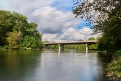 Concrete bridge over fox river on a cloudy day stock photography