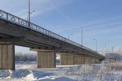 Concrete bridge over the frozen river Vaga Royalty Free Stock Photos