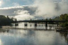 Concrete bridge over hazy water stock photography