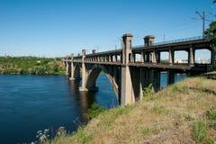 Concrete bridge over the river Stock Photos