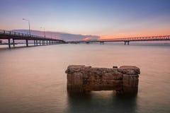 Concrete Bridge over sea water with sunrise Stock Photos