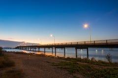 Concrete Bridge over sea water with sunrise Royalty Free Stock Photo