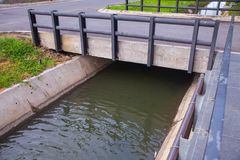 Concrete bridge over water. In the park Royalty Free Stock Images