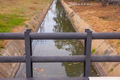 Concrete bridge over water. In the park Royalty Free Stock Photography