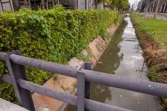 Concrete bridge over water. In the park Stock Photos