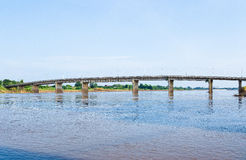 A concrete bridge passing over the river at  Thailand Stock Photo