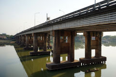 Concrete bridge on the river Stock Images