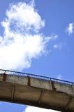 Concrete bridge under the sky. Concrete bridge under the blue sky with clouds Stock Photography