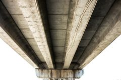Concrete bridge viewed from below. Concrete bridge  viewed from below.Modern architecture Royalty Free Stock Photography
