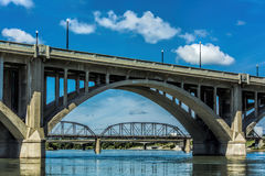 Concrete Bridge. A concrete bridge with visually pleasing arches across the river Royalty Free Stock Photos