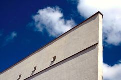 Concrete building. On a background of the dark blue sky and clouds Royalty Free Stock Image