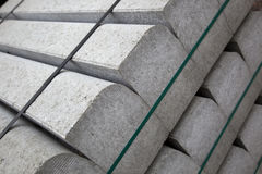 Concrete building blocks. A closeup of prefabricated concrete or cement building blocks at a construction site Royalty Free Stock Photos