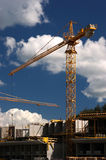 Concrete building built with tower crane Royalty Free Stock Images