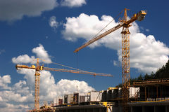 Concrete building built with tower crane. At nice cloudy sky Royalty Free Stock Image