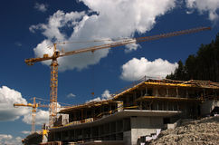 Concrete building built with tower crane Royalty Free Stock Photography