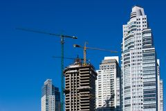 Concrete Building Construction with Cranes Stock Image