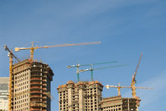 Concrete Building Construction with Cranes Stock Images