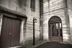 Concrete building and lamp post Stock Photos