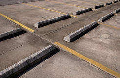 concrete bumpers,empty parking lot Stock Photos