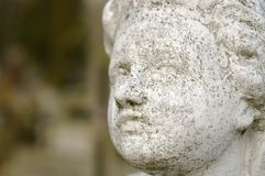 Concrete carved face of an angel Stock Photography