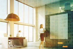 Concrete CEO office with a poster, corner, woman Royalty Free Stock Photos