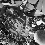 Concrete chaotic fragments of explosion destruction wall. Abstra Stock Photos