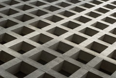 Concrete Checkerboard. This image shows a checkerboard pattern of a concrete building exterior Royalty Free Stock Image