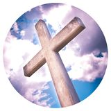 Concrete christian cross against a dramatic cloudy sky - - Round icon concept image - Photography in a circle.  royalty free stock photography