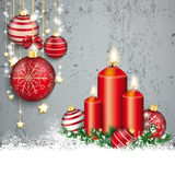 Concrete Christmas Cover Red Baubles Golden Stars Snow Candles. Red baubles with golden stars and candles on the concrete background Royalty Free Stock Image