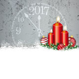 Concrete Christmas Red Baubles Snow Candles Clock 2017. Red baubles with clock 2017 and candles on the concrete background Stock Image