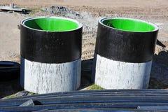 Concrete circle pit and PVC pipe Stock Photo