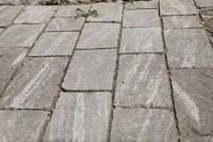 Concrete or cobble gray pavement slabs or stones for floor, wall royalty free stock image