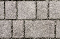 Concrete or cobble gray pavement slabs or stones. Stock Image