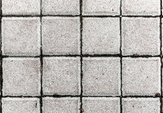 Concrete or cobble gray pavement slabs or stones. Royalty Free Stock Photo