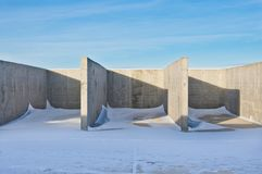 Concrete construction on the background of the winter landscape stock images