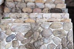 Concrete construction block with stones' decoration Royalty Free Stock Photos