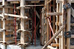 Concrete construction site. Wall and ceiling molds of wood with supporting shells and pillars Stock Images