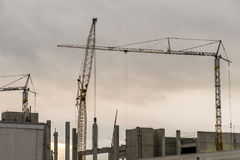 Concrete construction yard building site crane cloudy sky background Stock Photos