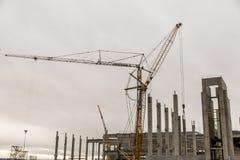 Concrete construction yard building site crane cloudy sky background Royalty Free Stock Photos
