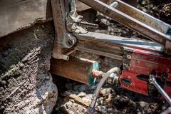 Concrete core drilling on construction site Stock Image