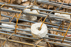 Concrete covering on rusty rebar Stock Photography