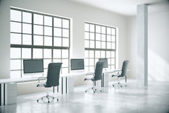 Concrete coworking office. Coworking office interior with computers, concrete floor, walls, columns and windows. 3D Rendering Royalty Free Stock Photo