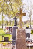 Concrete cross. In cemetery in spring royalty free stock photo